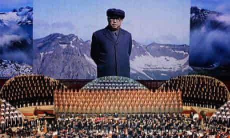 A portrait of North Korea founder Kim Il-sung is shown during a concert in Pyongyang