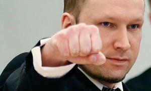 Anders Behring Breivik gestures at the start of the third day of proceedings in Oslo