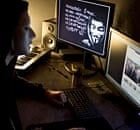 A masked hacker of the Anonymous group hacks the Elysée Palace website in January 2012