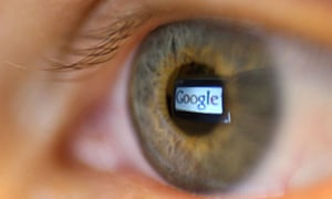 Google logo reflected in a person's eye