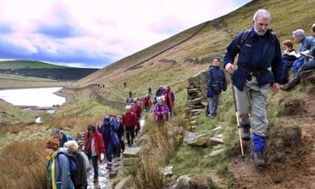 Ramblers walk through hills of Kinder Scout
