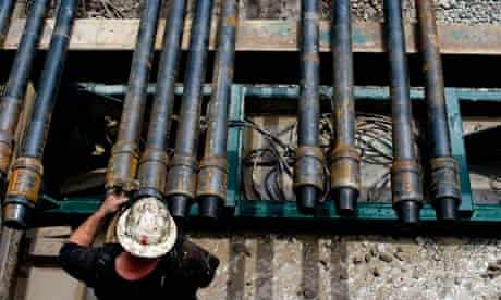 A worker prepares a shale gas drill pipe in Mannington, West Virginia, US