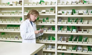 View of a pharmacist examining a pill packet