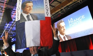 A Nicolas Sarkozy supporter flashes a V for victory sign at a rally on Saturday