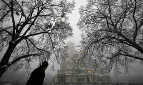A man walks past the golden domed Alexander Nevski cathedral in Sofia, Bulgaria