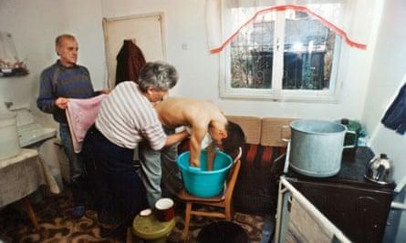 Jela and Zijo Dzino in 1995, washing their ill son Nermin