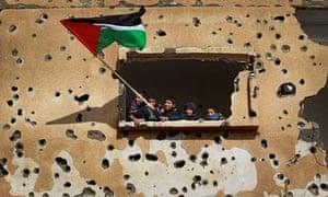 Children wave a Palestinian flag in the Gaza Strip