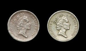 A fake British pound coin (left) alongside a genuine one