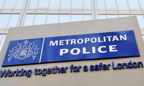 Metropolitan Police sign outside New Scotland Yard