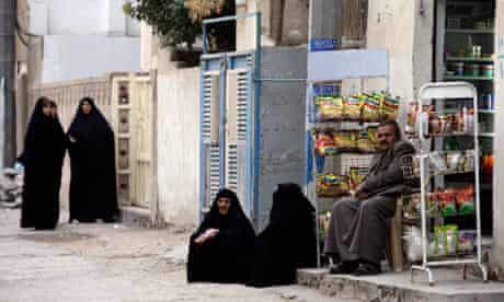 Shia and Sunni Muslims in the primarily Shiite neighbourhood of Hurriyah, north Baghdad
