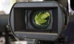 A leaf is seen through a video camera lens