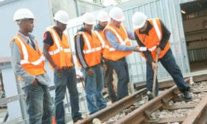 Young apprentices work on rail lines
