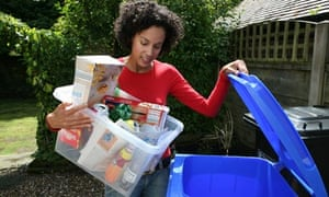 Woman recycles household waste
