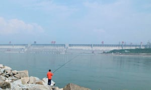 A man fishes in a reservoir near the Three Gorges Dam in Yichang, Hubei province, China