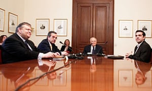 Greek President Carolos Papoulias and party leaders at the presidential palace in Athens.