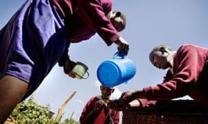 Africab children accessing clean drinking water