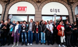 Protesters gather to protest the closing of the National Theater