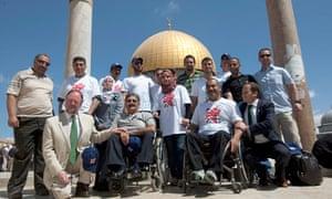 Palestinian Paralympians in front of al-Aqsa Mosque