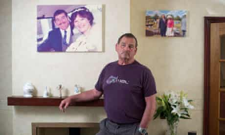 Bob Tonkin, in front of his wedding phto the day he married Eve, at home in Leedstown, Cornwall.