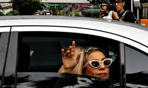 Lady Gaga waves to fans in Singapore, a stop on her Asian tour.