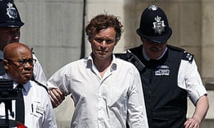 David Lawley-Wakelin being led away by police