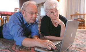 Elderly couple using a computer