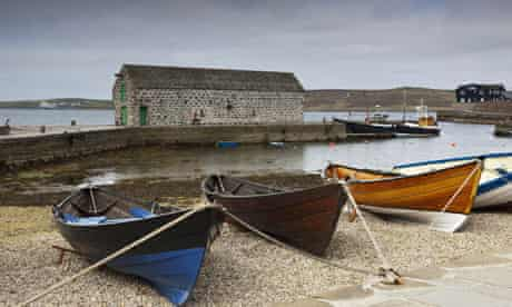 Boats lined up on the shore in Lerwick, Shetland Isles.
