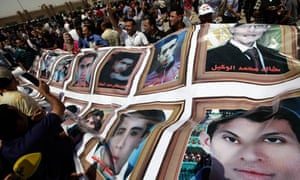 People react to Mubarak's life sentence outside the police academy court, in Cairo.