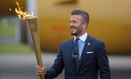David Beckham with the torch that lit the Olympic flame in the UK