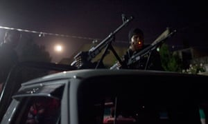 Free Syrian Army members prepare for an early morning attack on Idlib city