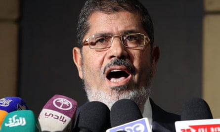 Muslim Brotherhood presidential candidate Mohamed Morsi speaks during a press conference in Cairo
