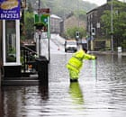 Floodwaters surround houses and shops in Hebden Bridge, West Yorkshire.