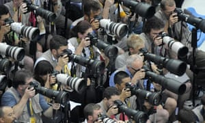 Photographers at work during the 2008 Beijing Games