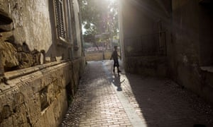 A boy walks through a street in the Turkish-controlled northern side of Nicosia, Cyprus