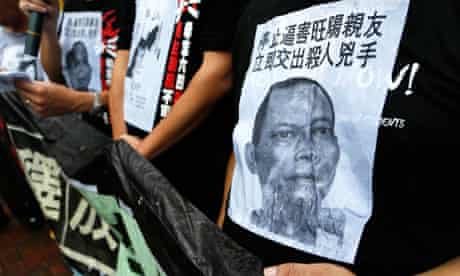 Protesters wear T-shirts with pictures of Li Wangyang during a pro-democracy rally in Hong Kong.
