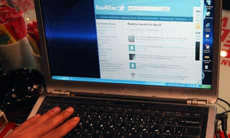 Man uses Twitter on his laptop