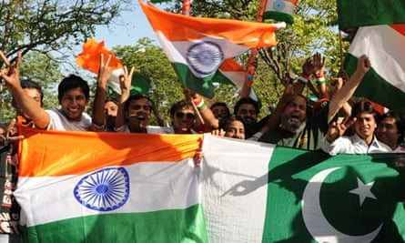 Indian cricket fans hold the Indian and Pakistan national flags