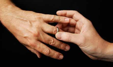 Male gay couple exchange rings
