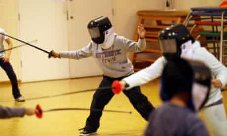 Children participate in fencing lessons