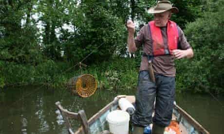 Bob Ringer catching crayfish