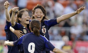 Japan's Sawa reacts with her teammates