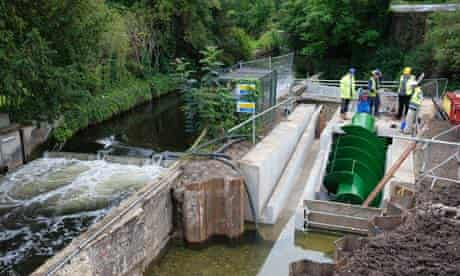 An Archimedes screw hydroelectric turbine is installed in the Wandle River in Morden Hall Park