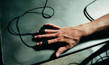 Person's hand hooked up to a lie detector