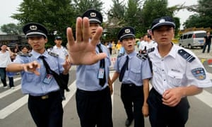 Police stop the media from filming after a Pro-Tibet demo near the Beijing national stadium