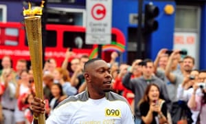 Are you listening? Dizzee Rascal with the Olympic torch.