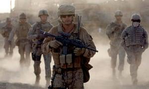 US marines on patrol near the town of Khan Neshin in Helmand, 2009