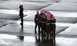 The body of a British soldier killed in Helmand is flown home, July 2009