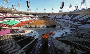 Olympic cauldron is repositioned in stadium