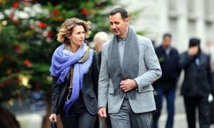 Asma Al-Assad with her husband in Paris in 2010.