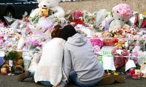 Two mourners at the shrine for Tia Sharp near her grandmother's home in New Addington.